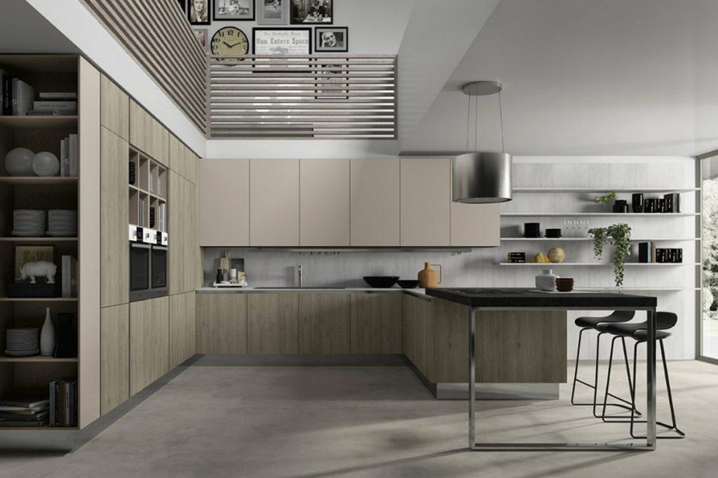 Cucina moderna con penisola, piano snack in pietra ed elementi a giorno. Arredamento Cucine Componibili CasaStore Salerno.