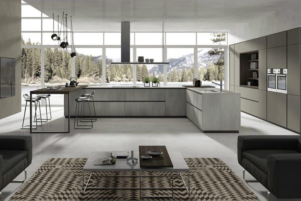 Cucina componibile in stile moderno con penisola in resina di cemento, colonne pensili area living e basi maxi. Cucine Componibili e Moderne CasaStore Salerno.