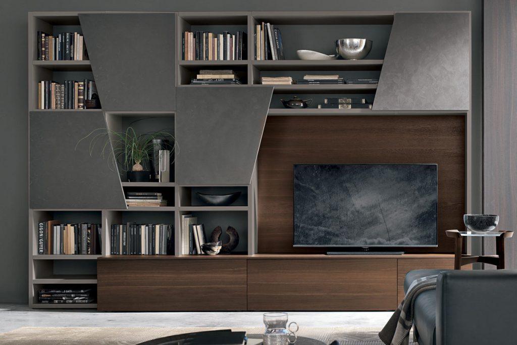 Libreria con basi e pannello porta TV in rovere termocotto, vani a giorno e contenitori con anta diagonal. Mobili moderni per il sggiorno CasaStore Salerno.