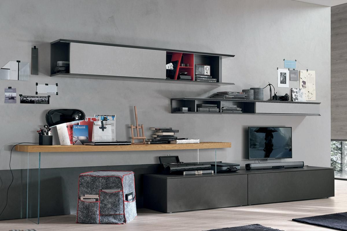 Parete attrezzata moderna con basi e pensili in finitura cemento e scrivania integrata. Arredamento per il soggiorno moderno CasaStore Salerno.