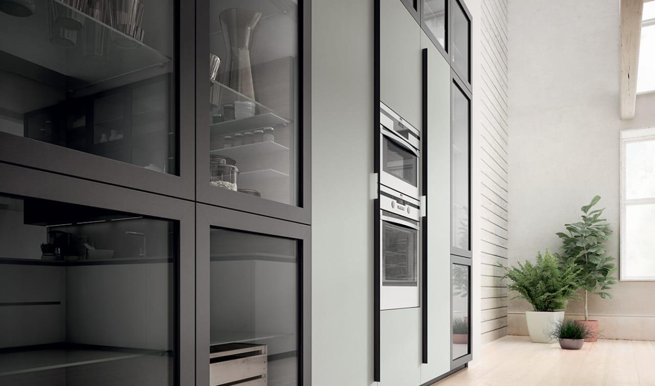 Cucina moderna con penisola colonne attrezzate e boiserie for Siniscalchi salerno arredo casa