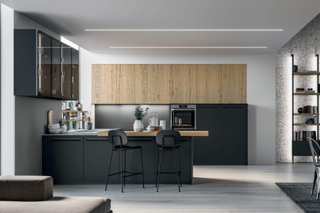 Cucina Tekna 04 composizione con a golfo con piano snack in rovere biondo. Cucine Arredo 3 Salerno - Arredamenti CasaStore.